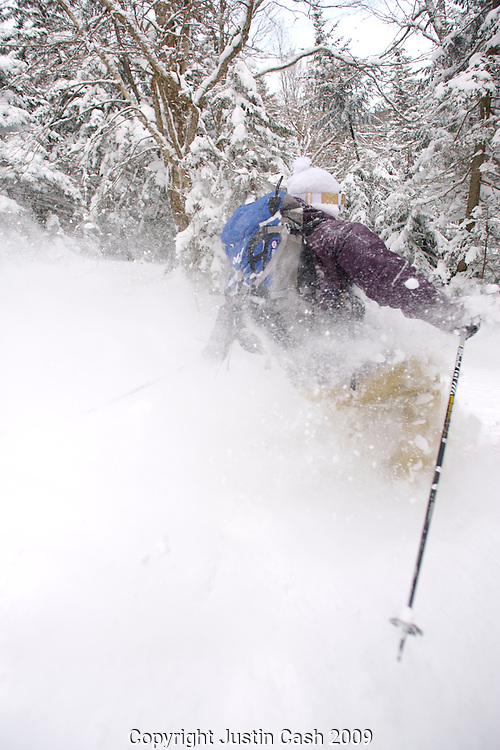 Skier enjoying very deep powder snow, Killington, Vermont