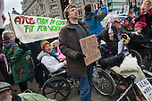 Wheelchair users chained together block the north side of Oxford Circus in a UK Uncut and Disabled People Against Cuts (DPAC) protest against the Welfare Reform Bill.