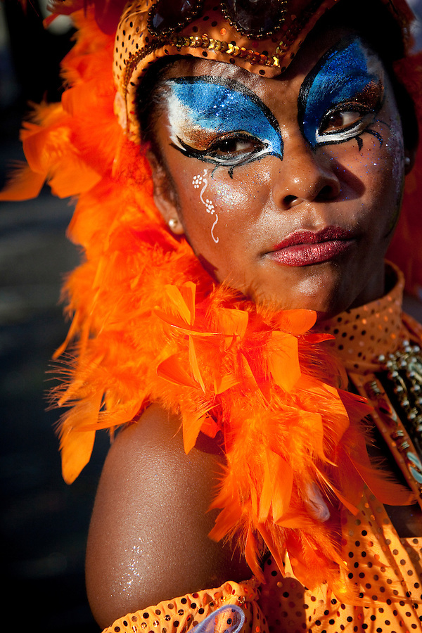 A female dancer in the parade of Llamadas in Montevideo.  One of the most imporant elements of Carnaval in Uruguay is Candombe, an African drum rhythm played on tambor drums.  It was revitalized in the Americas by black slave descendents as a way by which to reclaim their cultural heritage and battle for civil rights.
