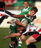 Manawatu lock Mike Fitzgerald is tackled by Matt Holloway as Sikeli Nabou closes in during the Air NZ Cup rugby match between Manawatu Turbos and Counties-Manukau Steelers at FMG Stadium, Palmerston North, New Zealand on Sunday, 2 August 2009. Photo: Dave Lintott / lintottphoto.co.nz