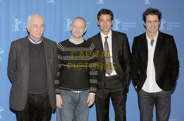 "ARMIN MUELLER-STAHL, ULRICH THOMSEN, CLIVE OWEN & TOM TYKWER.Photocall for ""The International"" during the Berlinale 2009, 59th International Berlin Film Festival, Berlin, Germany..February 5th 2009.half length black suit jacket grey gray striped stripes top jumper .CAP/PPG/JH.©Jens Hartmann/People Picture/Capital Pictures"