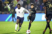 CARY, NC - DECEMBER 13: David Wrona #13 of Wake Forest University kicks the ball away from Daryl Dike #9 of University of Virginia during a game between Wake Forest and Virginia at Sahlen's Stadium at WakeMed Soccer Park on December 13, 2019 in Cary, North Carolina.
