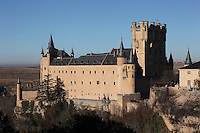 Great Tower of John II, 15th century, Alcazar, 12-16th centuries,  Segovia, Castile and Leon, Spain. The current Alcazar was begun by King Alfonso VIII (1155-1214) and his wife Eleanor of England (1162-1214), and rebuilt 1258. Juan (John) II (1405-54) added the Gothic style Great Tower. Philip II (1527-98) modified the roofs with slate spires in Northern European style. The Alcazar was subsequently a state prison until it became the Royal Artillery School, 1762. It was damaged by fire, 1862 and restored, 1882, becoming a Military College, 1896. Picture by Manuel Cohen