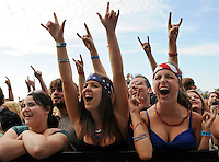 Callan VanHemert, 18, right, and Kayla Malhas, 18, center, both of Ann Arbor, donned patriotic attire during the Matt Nathanson concert where they and Amanda Flynn, 23, of Montague, left, enjoyed a front row view of the performance on the tenth day of the Muskegon Summer Celebration at Heritage Landing on Saturday. ..Date Shot: 07/04/09