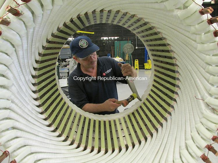 THOMASTON, CT-12 November 2013- 111213AG01- Heriberto Gomez works on a Three-phase Form Wound Stator, a motor made by Ward Leonard LLC. Contributed photo.