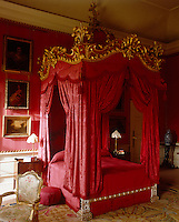 A State Bedroom at Petworth House is resplendent in deep red damask