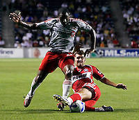 Chicago Fire defender Gonzalo Segares (25) slide tackles the ball away from Toronto FC midfielder Marvell Wynne (16).  The Chicago Fire tied Toronto FC 1-1 at Toyota Park in Bridgeview, IL on July 7, 2007.