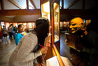 NWA Democrat-Gazette/JASON IVESTER <br /> Kate Ramirez leans in to align her reflection with a display on Wednesday, Sept. 30, 2015, inside the Museum of Native American History in Bentonville. Kate and other fifth-graders from Westood Elementary School in Springdale were visiting the museum as part of the Magical History Tour which also included tours of the Peel Mansion Museum and Walmart Museum.