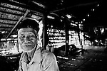 """Mekong Dam Victims - Cambodia. One of the old inhabitants who have decided to move the village up in the hills, far away from the original setting on the riverbank. At least 55.000 people living near the Sesan river in Cambodia's Ratanakiri and Stung Treng provinces continue to suffer due to lost rice production, lost fishing income, drowned livestock and damaged vegetable gardens, and so also great economical losses, because of the unpredictable floodings from the Yali Falls Dam on the other side of the border in Vietnam. To this day, flash floodings have caused the deaths of at least 39 villagers from various ethnic minority groups living along the river. Despite this, four other major hydropower projects are now in operation or under construction on the Sesan River in Vietnam. Known as """"The Mother of Waters"""", more than 60 million people depend on the Mekong river and its tributaries for food, fresh water, transport and other aspects of daily life. The construction of big dams is now threatening the life of these people aswell as the vital and unique ecosystem of the river."""