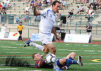 Andrew Marshall #5 of Crystal Palace Baltimore slides into Eduardo Sebrano #12 of the Montreal Impact during an NASL match at Paul Angelo Russo Stadium in Towson, Maryland on August 21 2010. Montreal won 5-0.