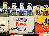 A six-pack of SABMiller's Peroni beer on the shelf with other brands in a supermarket in New Yorkon Thursday, February 11, 2016. The Japanese Asahi brewery is reported to be in talks with SABMiller to buy their Peroni, Grolsch and other brands in a deal reported to be $2.9 billion. (© Richard B. Levine)