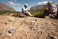 150620-JRE-7981E-0344 Cal Trout, left, and Joshua Quong, right, both teachers and quail hunting guides from Mississippi, prepare their fly rods before hiking into a remote interior Alaska stream to fish for Arctic Grayling.