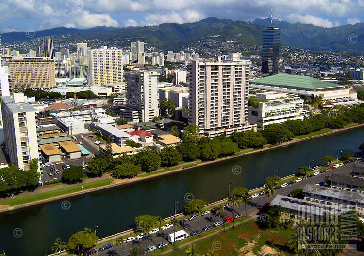 View of hotels and residences along the Ala Wai canal which lines the back side of Waikiki