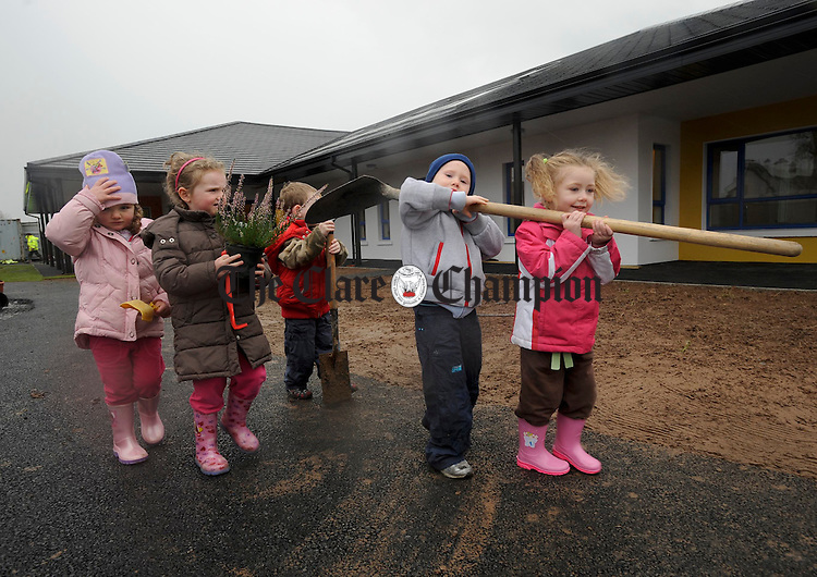 Sorcha Flanagan, Lauren O Connell and Jack Finucane, Cian Mc Donagh and Bridget Mc Donagh give a helping hand with the finishing touches at the Clare Family Resource Centre Creche at Watery Road Ennis. Photograph by John Kelly.