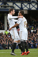 Gylfi Sigurdsson celebrates scoring his sides first goal with Wayne Routledge during the Barclays Premier League match between Everton and Swansea City played at Goodison Park, Liverpool. 0-1