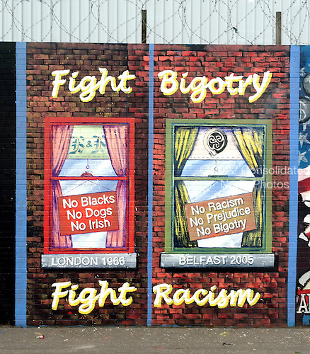 Belfast, Northern Ireland - August 14, 2005 -- Wall murals along Falls Road in Belfast, Northern Ireland on August 14, 2005.  Falls Road is in one of the Catholic neighborhoods in Belfast.  The murals reflect their political positions on many national and international issues.  This mural is against bigotry and racism..Credit: Ron Sachs / CNP