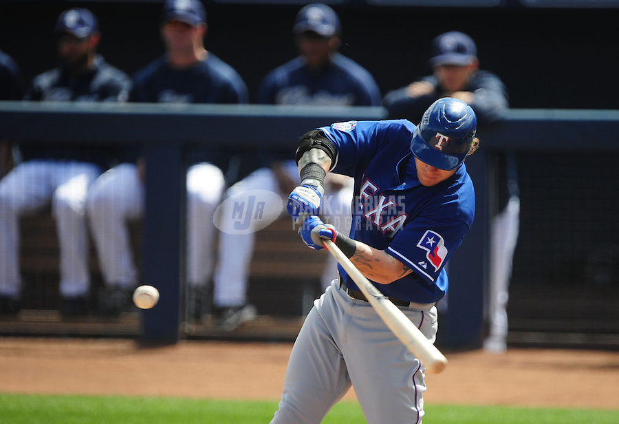 Mar. 7, 2012; Peoria, AZ, USA; Texas Rangers outfielder Josh Hamilton bats during the first inning against the San Diego Padres at Peoria Stadium.  Mandatory Credit: Mark J. Rebilas-.