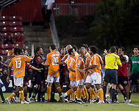 Houston Dynamo and Atlante FC players confront each other the field resulting in red card ejections for Dynamo midfielder Dwayne De Rosario (14) and Javier Munoz Mustafa (2). Houston Dynamo defeated Atlante FC 4-0 during the group stage of the Superliga 2008 tournament at Robertson Stadium in Houston, TX on July 12, 2008.