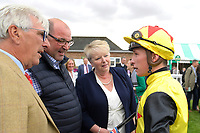 Jockey of Kenzai Warrior talks to owners and trainer Roger Teal in the Winner's enclosure after winning The Irish Thoroughbred Marketing Novice Stakes  during Racing at Salisbury Racecourse on 5th September 2019