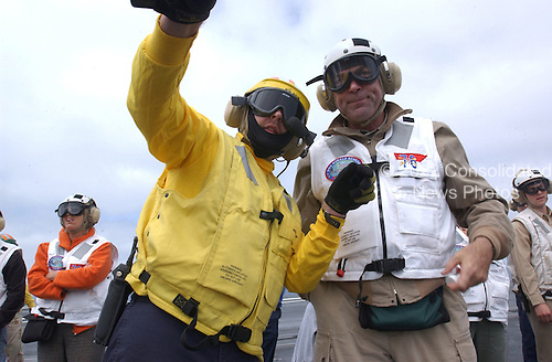 Aviation Boatswain's Mate Handling 1st class Dennis D. Parker explains the ships aircraft catapult system to actor Tom Selleck on the flight deck aboard USS Ronald Reagan's (CVN 76) on July 22, 2004. Tom Selleck was aboard Reagan to welcome the ship's crew to Naval Air Station North Island, San Diego, California. Homeporting ceremonies for the United States Navy's newest and most technologically advanced aircraft carrier will host various dignitaries, including Nancy Reagan, members of the Congress, state officials and various celebrities. Reagan is commanded by Captain James A. Symonds. While in transit, the ship visited the ports of Rio de Janeiro, Brazil, Valparaiso, Chile, and Callao, Peru.  <br /> Mandatory Credit: Kathleen Gorby / USN via CNP