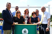 Sponsors of The Wateraid Mildren Construction Maiden Fillies' Stakes (Plus 10), present the trophy to the connection of Neshmeya trained by Charles Hills  during Father's Day Racing at Salisbury Racecourse on 18th June 2017