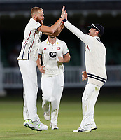 Ivan Thomas (L) of Kent enjoys a high-five with Heino Kuhn after bowling Ravi Patel during the County Championship Division 2 game between Kent and Middlesex at the St Lawrence Ground, Canterbury, on June 25, 2018