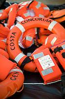 Island of Giglio, Italy, January 15, 2012. I giubetti salvagente utilizzati per abbandonare la nave Concordia..Life jackets used to abandon the cruise ship Costa Concordia lies at the Giglio port.