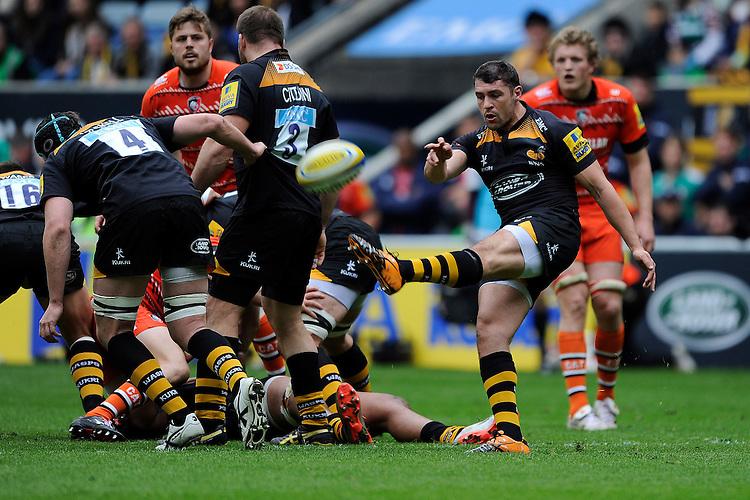 Charlie Davies of Wasps sends up a box kick