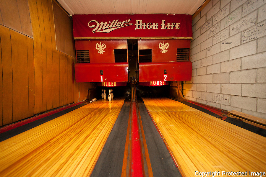 A view of bowling lanes in the basement of The Holler House bar in Milwaukee, Wisconsin during the Great Bra Rehanging event on June 14, 2013. A city inspector ordered bar owner Marcy Skowronski to take the bras, which have been hanging in the bar for the last 45 years as tradition, down in April, saying they were a fire hazard, but has since backed out of the order.