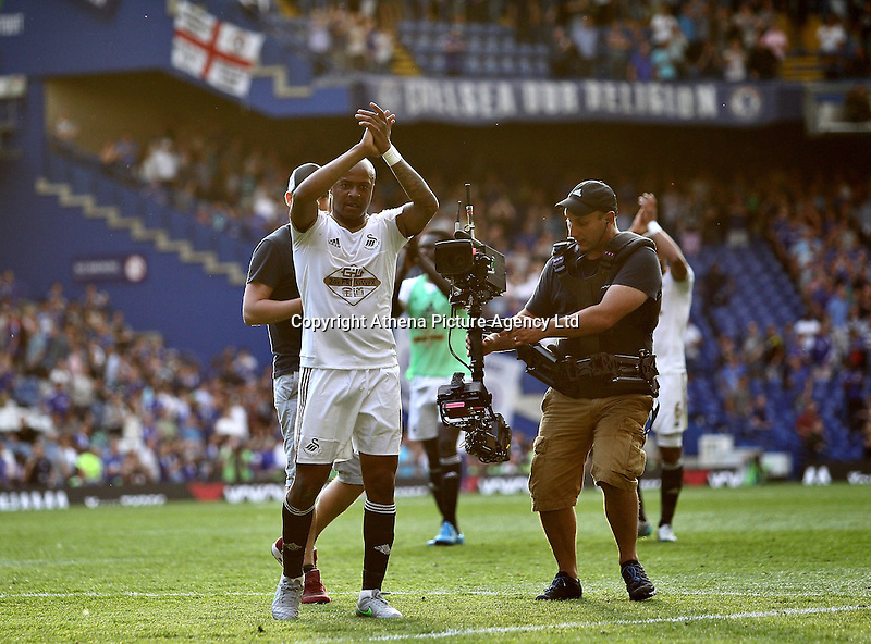 Andre Ayew of Swansea applauds the fans   during the Barclays Premier League match between  Chelsea and Swansea  played at Stamford Bridge, London