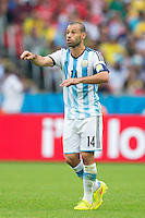 Javier Mascherano of Argentina shouts instructions