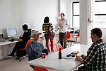 BROOKLYN -- APRIL 22, 2011: Erica Heinz (L), Chris Shiflett (2L), Maria Popova (C), William Burks Spencer (2R) and  Cameron Koczon(R) at work at Studiomates on April 22, 2011 in Dumbo, Brooklyn.   (PHOTOGRAPH BY MICHAEL NAGLE)