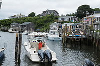 Boats and houses are seen in Chilmark/Menemsha, Martha's Vineyard, Massachusetts, USA.