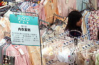 Women look at underwear in the lingerie section of a supermarket in Guangzhou, China..10-DEC-04