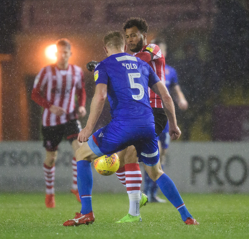 Lincoln City's Matt Green vies for possession with Morecambe's Steven Old<br /> <br /> Photographer Chris Vaughan/CameraSport<br /> <br /> The EFL Sky Bet League Two - Saturday 15th December 2018 - Lincoln City v Morecambe - Sincil Bank - Lincoln<br /> <br /> World Copyright © 2018 CameraSport. All rights reserved. 43 Linden Ave. Countesthorpe. Leicester. England. LE8 5PG - Tel: +44 (0) 116 277 4147 - admin@camerasport.com - www.camerasport.com
