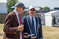 """Henley on Thames, United Kingdom, 3rd July 2018, Sunday,  """"Henley Royal Regatta"""",  (left) Henley Steward,  Jamie COVEN, in discussion with Yale Coach, Steve Gladstone (right) View, Henley Reach, River Thames, Thames Valley, England, UK."""