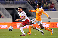 Dwayne De Rosario (11) of the New York Red Bulls plays the ball as Alex Dixon (19) defends. The New York Red Bulls  and the Houston Dynamo played to a 1-1 tie during a Major League Soccer (MLS) match at Red Bull Arena in Harrison, NJ, on April 02, 2011.