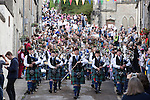 Langholm Common Riding 2016. Pipe band marches down Kirk Wynd with procession behind them