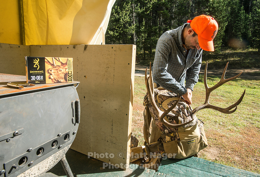 Outdoor Life Editor Andrew McKean packs up his trophy antlers after mule deer hunting with Trefren Outfitters on Greyback Ridge in the Hoeback Drainage of Wyoming Region H, outside of Alpine, Wyoming, September 24, 2015.<br /> <br /> Photo by Matt Nager
