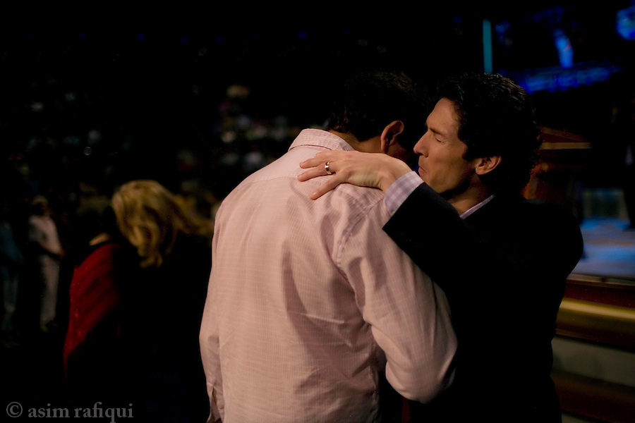 Joel Oelsteen, pastor at Lakewood Church, the world's largest megachurch, participates in a public prayer session<br />