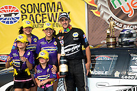 Jul. 28, 2013; Sonoma, CA, USA: NHRA pro stock driver Vincent Nobile celebrates with crew and family after winning the Sonoma Nationals at Sonoma Raceway. Mandatory Credit: Mark J. Rebilas-