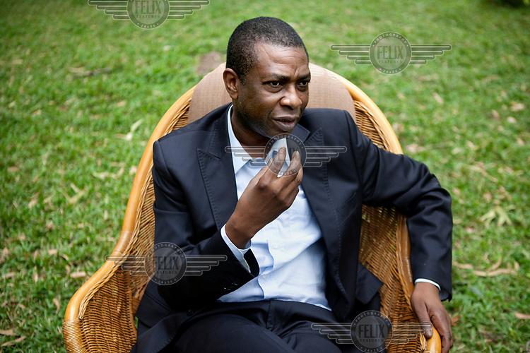 Musician Youssou N'Dour in the garden at his home in Dakar.