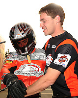Nov. 13, 2011; Pomona, CA, USA; NHRA pro stock motorcycle rider Eddie Krawiec (left) is congratulated by teammate Andrew Hines after clinching the 2011 championship during the Auto Club Finals at Auto Club Raceway at Pomona. Mandatory Credit: Mark J. Rebilas-.