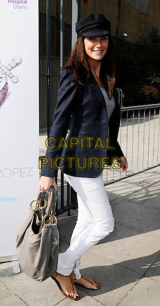 "CLAIRE MERRY .At the 2nd ""Mummy Rocks"" Fundraising event, The Tabemrche, powis Square, London, England, UK, March 21st 2009..full length navy jacket white jeans trousers grey gray bag cap hat black blazer sandals thong sandals clare .CAP/CAN.©Can Nguyen/Capital Pictures"