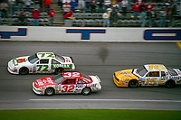 Rusty Wallace  (72) Dale Jarrett (32) , Geoff Bodine (15)  action Busch series race  at Daytona International Speedway on February 1989.  (Photo by Brian Cleary/www.bcpix.com)