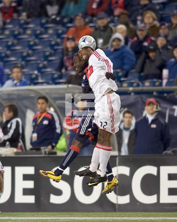 New England Revolution forward Kheli Dube (11) and Chicago Fire defender Dasan Robinson (32) battle for head ball. The New England Revolution tied the Chicago Fire, 0-0, at Gillette Stadium on October 17, 2009.