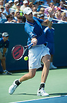 John Isner (USA) loses to Rafael Nadal (ESP), 7-6(8), 7-6(3)  at the Western & Southern Open in Mason, OH on August 18, 2013.