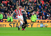 2nd December 2017, bet365 Stadium, Stoke-on-Trent, England; EPL Premier League football, Stoke City versus Swansea City;  Darren Fletcher of Stoke City is challenged by Jordan Ayew of Swansea City