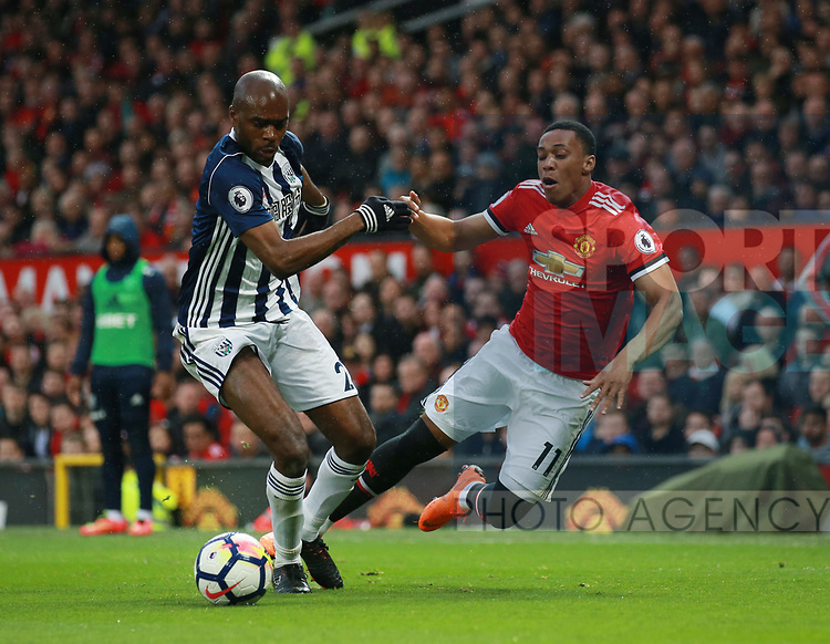 Anthony Martial of Manchester United fouled by Allan-Romeo Nyom of West Bromwich Albion during the premier league match at the Old Trafford Stadium, Manchester. Picture date 15th April 2018. Picture credit should read: Simon Bellis/Sportimage