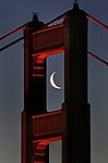 Crescent moon is tucked into a frame like setting at the north tower of the Golden Gate Bridge in San Francisco, California.